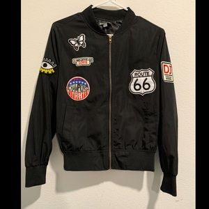 Black bomber with patches